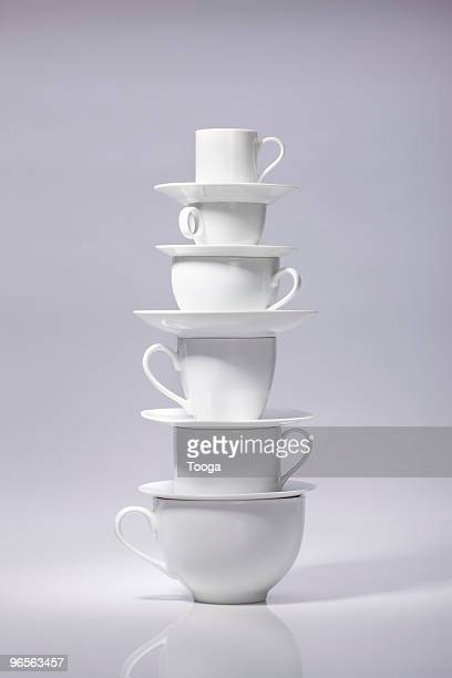 stack of various coffee cups - crockery stock pictures, royalty-free photos & images