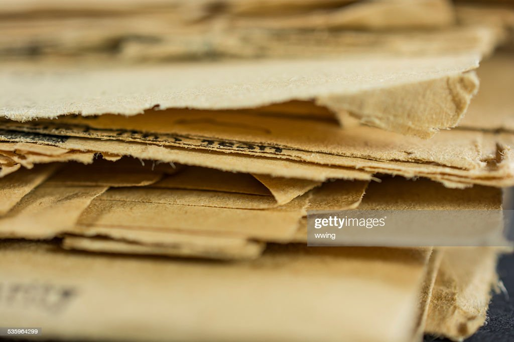 Stack of very old Yellowed Newspapers : Stock Photo