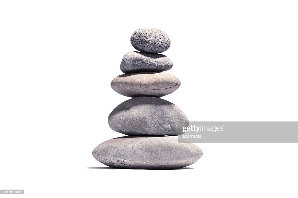 Stack of volcanic pebbles isotaded on white with clipping path : Stock Photo
