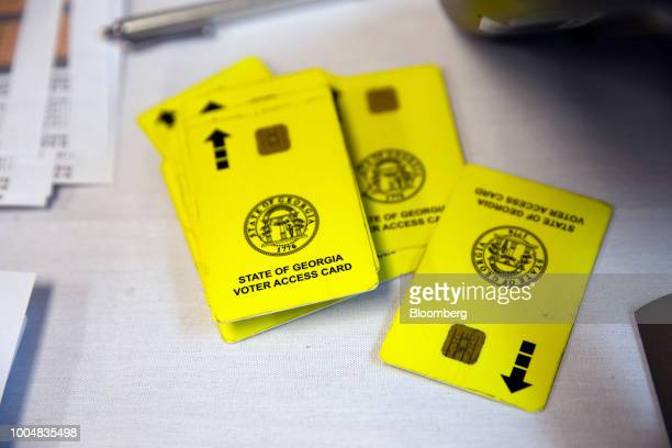 A stack of voter access cards sit on a table at a polling location during the Georgia primary runoff elections in Atlanta Georgia US on Tuesday July...