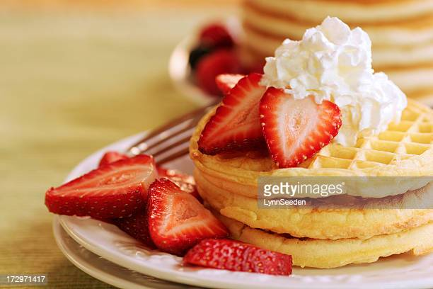 A stack of waffles with strawberries