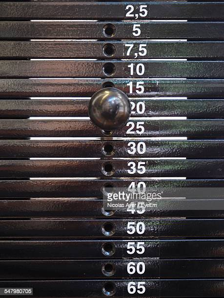 stack of weights in gym - mass unit of measurement stock pictures, royalty-free photos & images
