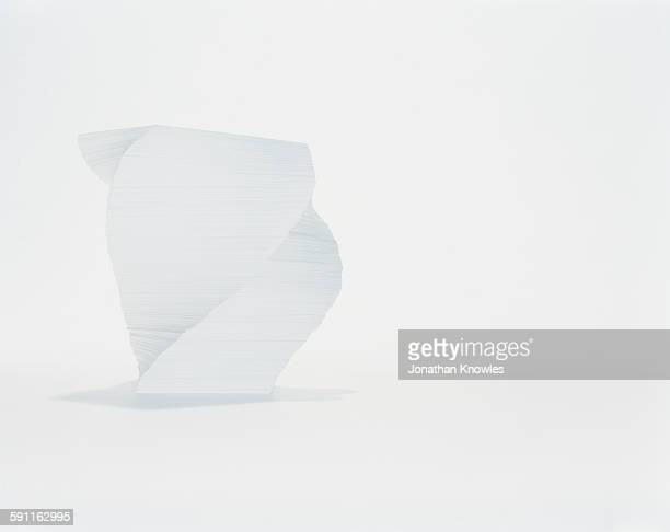 Stack of white paper on white background