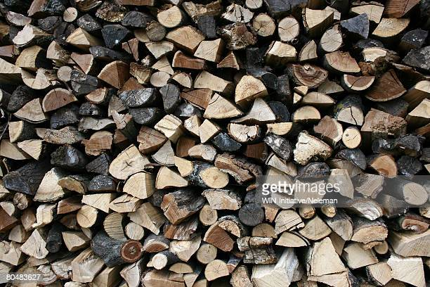 stack of wood, full frame - firewood stock pictures, royalty-free photos & images