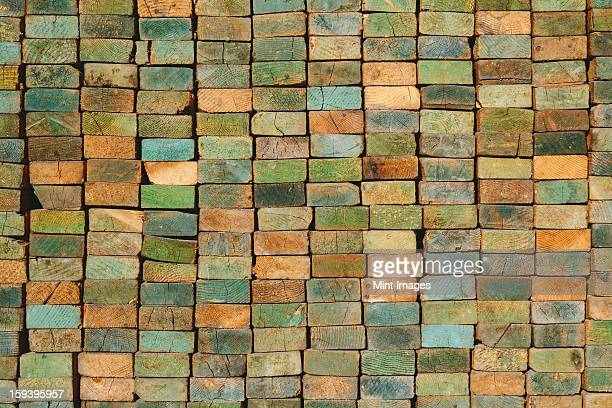 A stack of wood stud boards known as 2 x 4s. Used for construction and scaffolding.