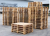 Stack of wooden pallets at warehouse