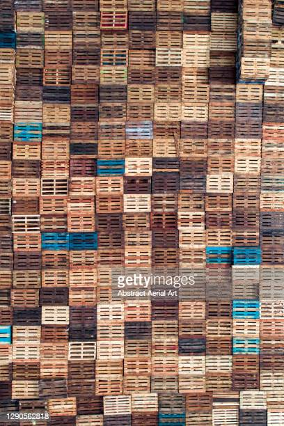 stack of wooden pallets photographed from directly above, england, united kingdom - pallet industrial equipment stock pictures, royalty-free photos & images