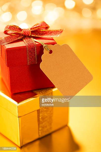 Stack of yellow and red gifts afront blurry background