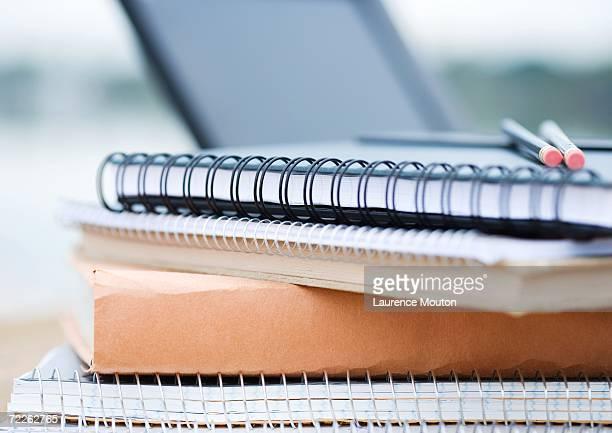stack on books and notebooks - schulbuch stock-fotos und bilder