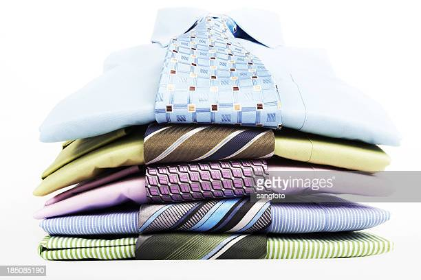 stack pile of men's blue shirts and ties folded - overhemd en stropdas stockfoto's en -beelden