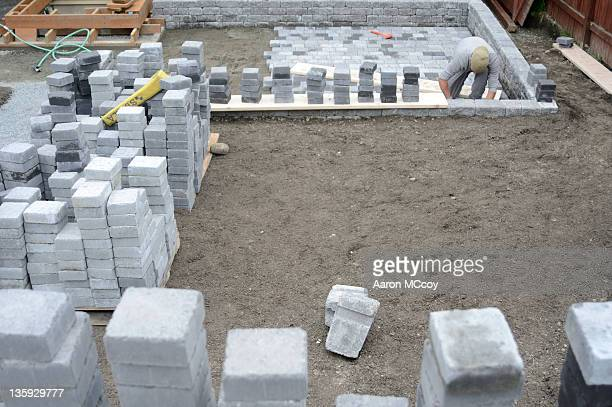 stack them and set them - paving stone stock pictures, royalty-free photos & images
