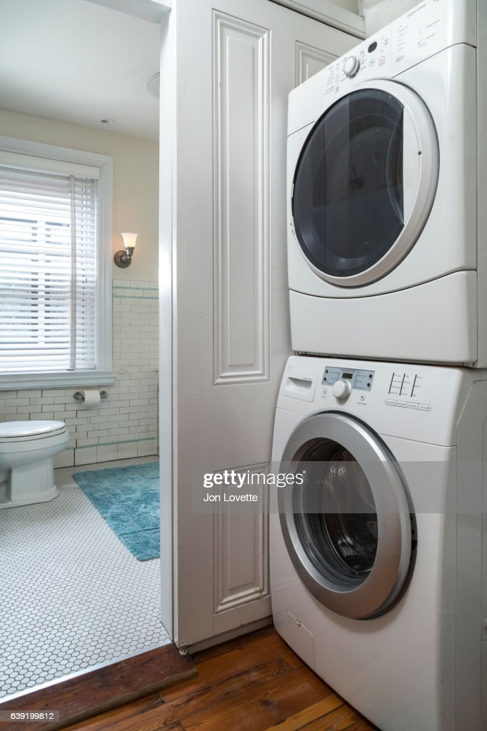 Stackable Washer And Dryer In Apartment High-Res Stock Photo ...