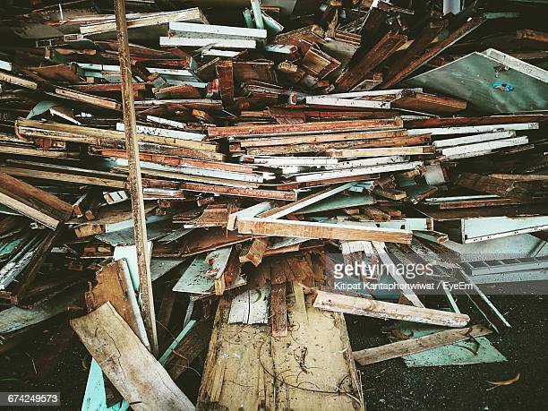 stacked abandoned wooden furniture at junkyard - obsolete stock pictures, royalty-free photos & images
