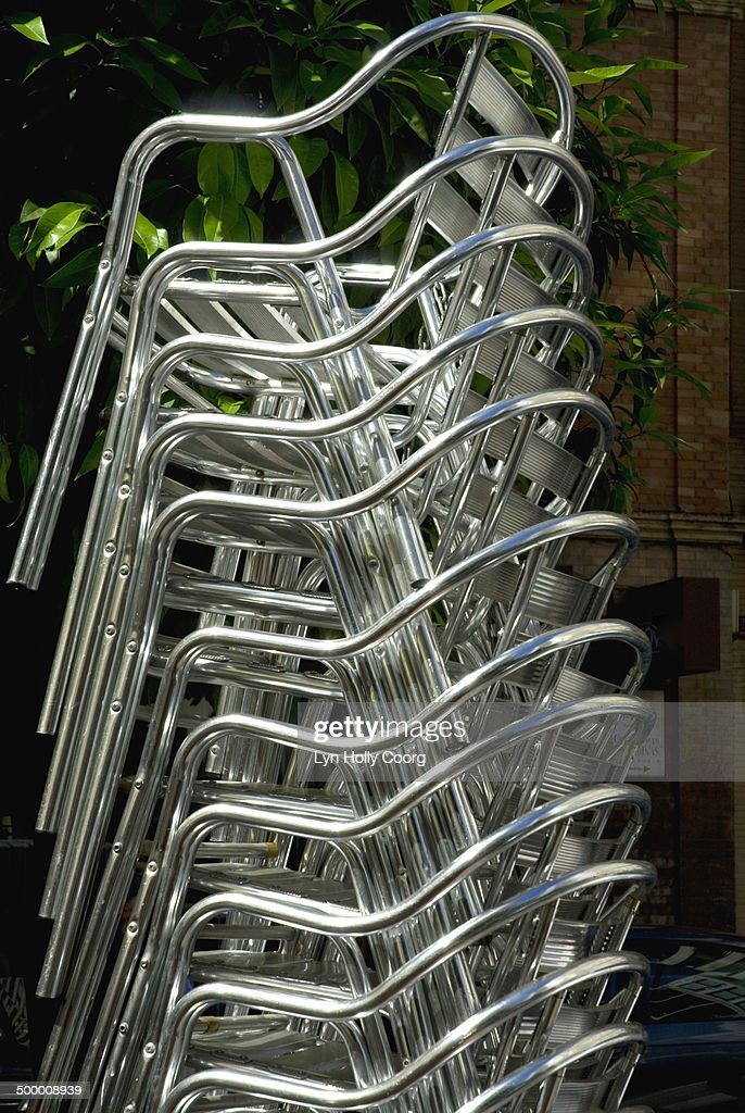 Stacked aluminium cafe chairs : Stock Photo