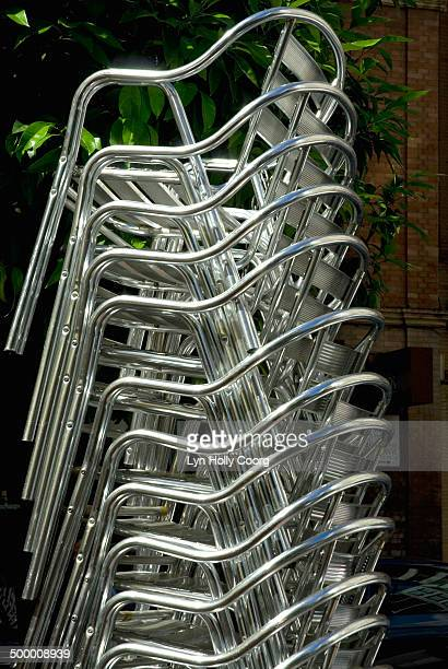 stacked aluminium cafe chairs - lyn holly coorg photos et images de collection