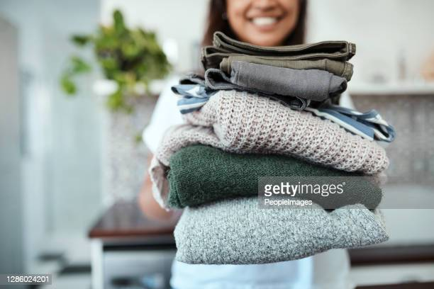 stacked and ready to be packed - clothing stock pictures, royalty-free photos & images