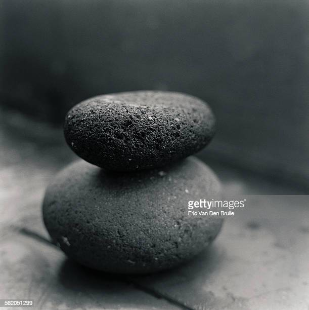 stacked black stones - eric van den brulle stock pictures, royalty-free photos & images