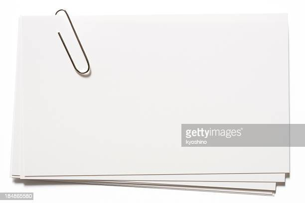 stacked blank white cards with paper clip on white background - paper clips stock photos and pictures
