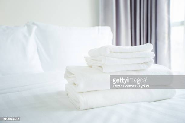 stacked blankets on bed at home - towel stock pictures, royalty-free photos & images