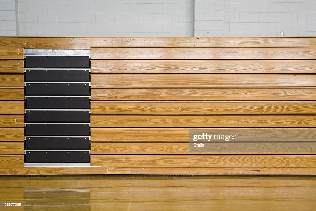 Stacked bleachers in a sports hall : Stock Photo