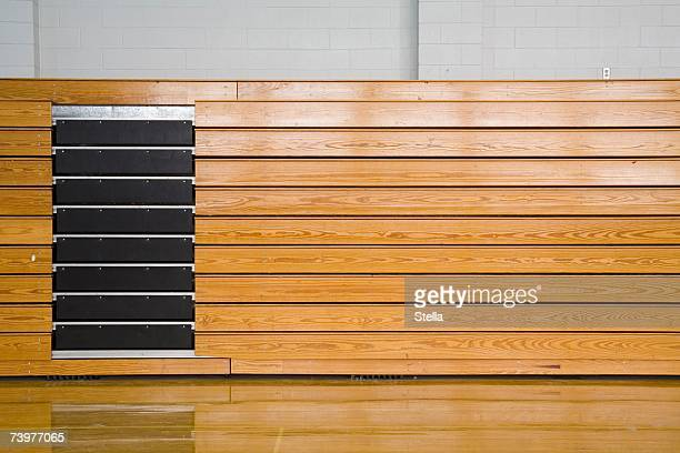Stacked bleachers in a sports hall