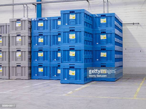 Stacked blue crates in factory