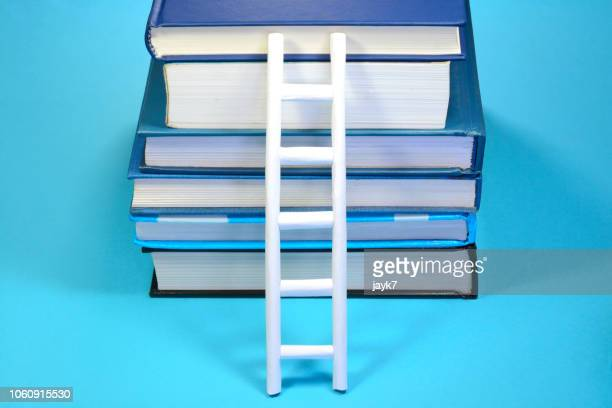 stacked books - weisheit stock-fotos und bilder