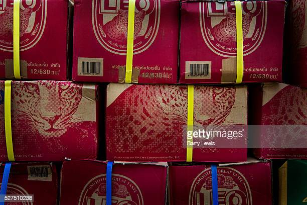 Stacked boxes containing Singha beer Thailand