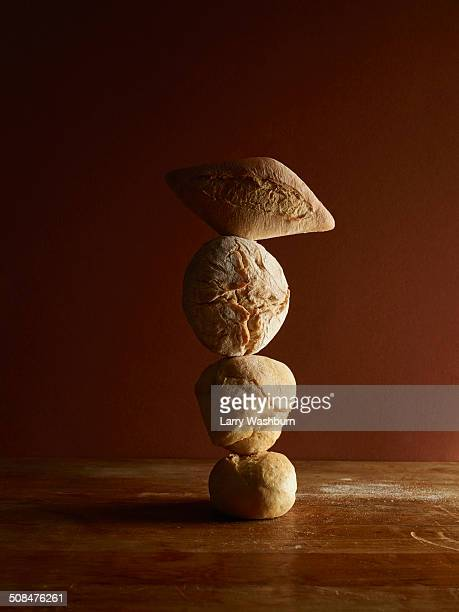 Stacked breads on wooden table