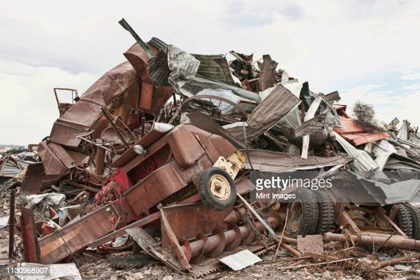 stacked car parts in junkyard - scrap metal stock photos and pictures