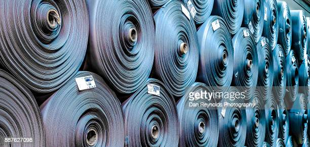 Stacked Carpet Rolls as Abstract