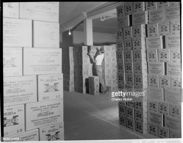 Stacked cases of ammunition Stacked cases of ammunition awaiting shipment at the ammunition division of East Alton Works Location East Alton Illinois...