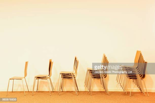 Stacked chairs arranged in a row