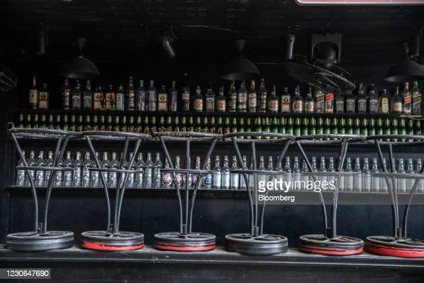 Stacked chairs inside a closed bar at Bangla Road in Patong, Phuket, Thailand, on Saturday, Dec. 19, 2020. The tepid response to Thailands highly...