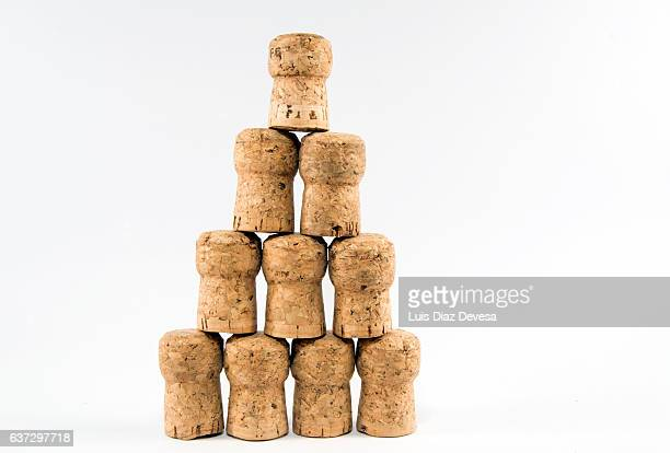 stacked champagne corks - wine cork stock photos and pictures