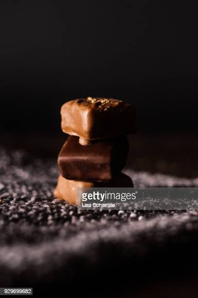 stacked chocolate pralines - traditionally belgian stock pictures, royalty-free photos & images