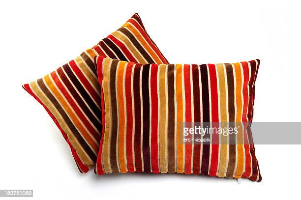 stacked colorfully cushions - cushion stock photos and pictures