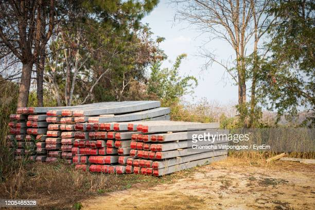 stacked concrete electric pole on the ground prepare to use - pole stock pictures, royalty-free photos & images