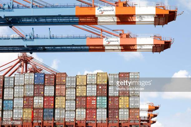 Stacked containers are seen on a container ship as it is moored at the Eurogate container terminal in the Hamburg Port during the novel coronavirus...