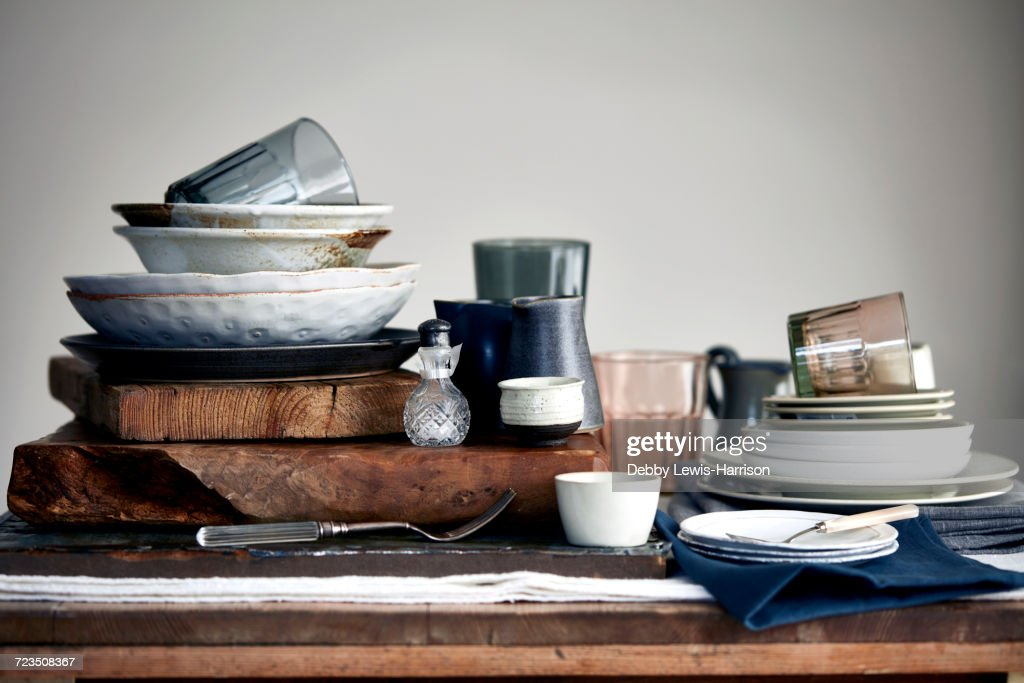 Stacked crockery stacked on cutting board for washing up : Stock Photo