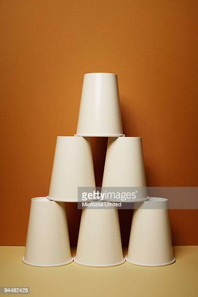 stacked cups - microzoa stock pictures, royalty-free photos & images