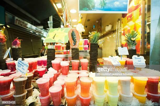 Stacked drinks display at fresh fruit juice shop