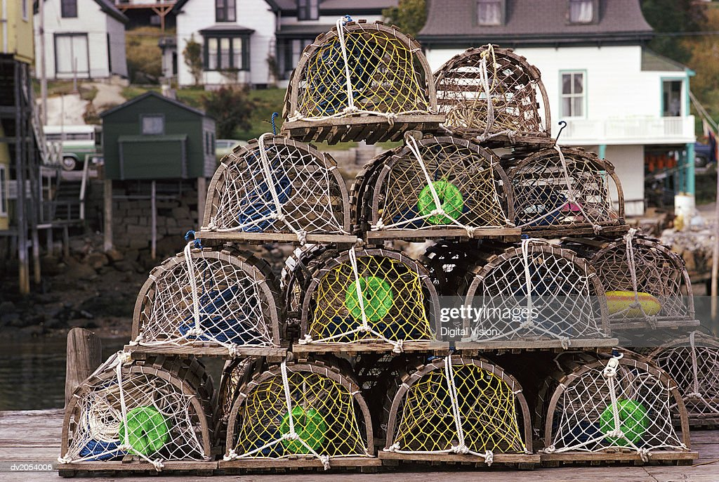 Stacked Fishing Cages on a Pier : Stock Photo