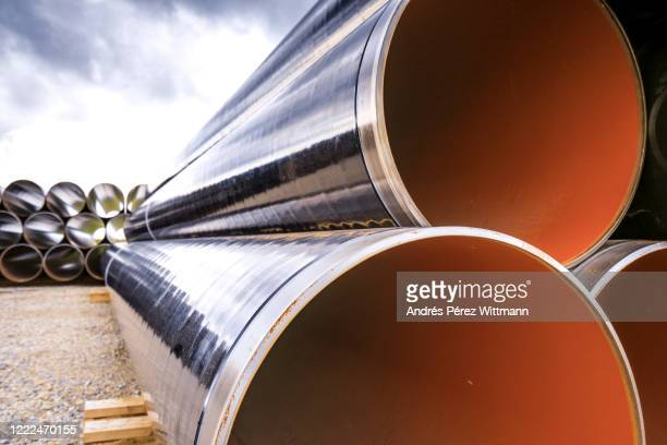 stacked gas pipes before burial - pipe stock pictures, royalty-free photos & images