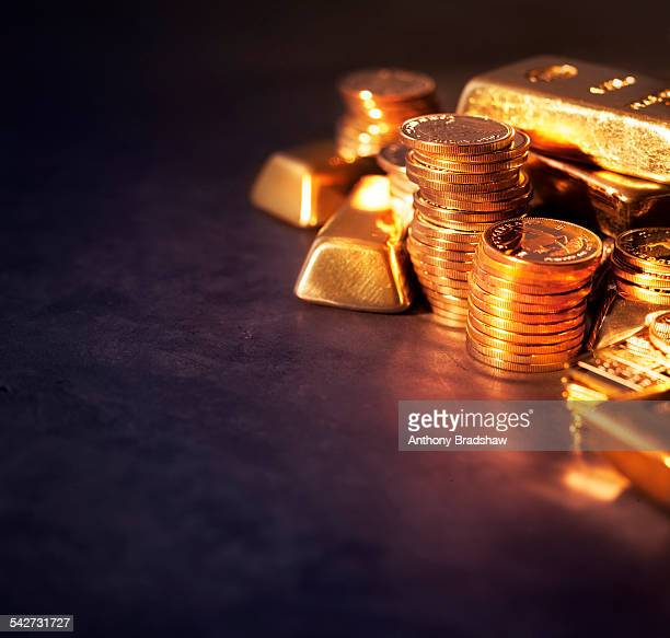 Stacked gold ingots and coins
