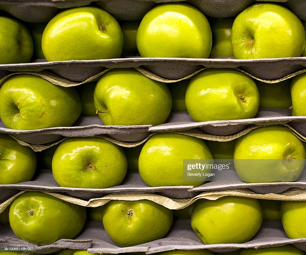 Stacked Granny Smith apples : Stockfoto