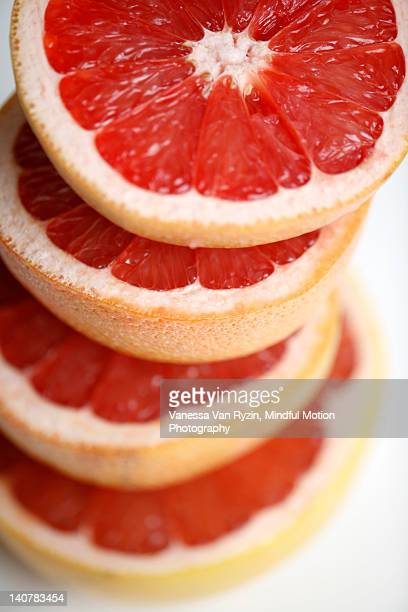 stacked grapefruit - vanessa van ryzin stockfoto's en -beelden