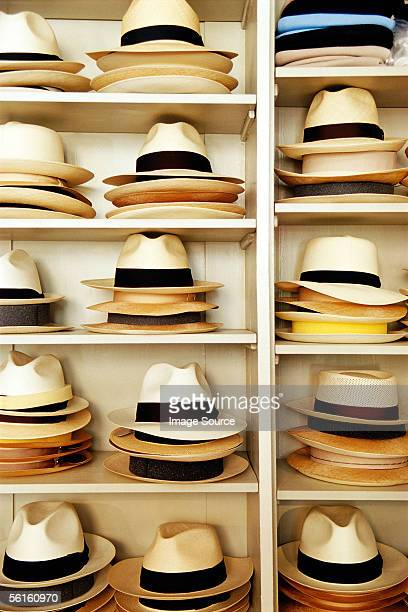 stacked hats on shelves - straw boater hat stock pictures, royalty-free photos & images