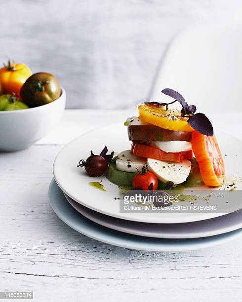 Stacked heirloom tomatoes and cheese