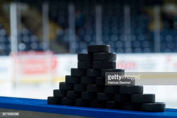 Stacked hockey pucks stand on the boards at Prospera Place on February 23 2018 in Kelowna Canada